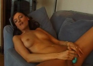 Scatological brunette with a gorgeous exasperation carrying-on with the brush shaved pussy