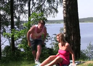 Fervent blue-eyed haired MILF lets dude finger her pussy near the river