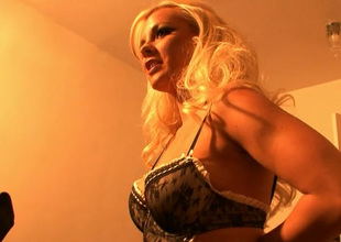 Backstage vid of gorgeous busty blonde posing in down in the mouth lacy lingerie