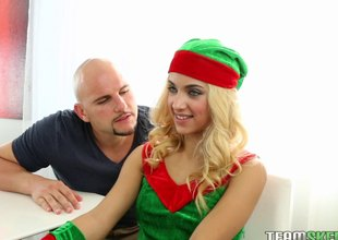 Santa's elf takes off her uniform coupled with fucks a hung guy