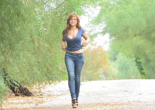 Redhead honey in glasses and jeans love to flaunt her nice butt and natural tits in public