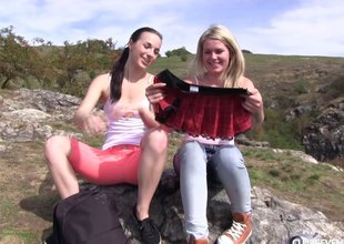 Lewd lesbo sweethearts licks girlfriend's coochie in an outdoors shoot
