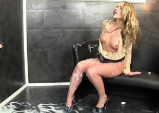 Glamourous golden-haired ends up covered in elusive cream at a gloryhole