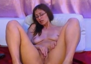 Big-assed milf in glasses fingers her cooch in webcam unaccompanied show