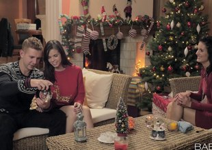 Couple receives in the Christmas spirit by attracting a bisexual girl