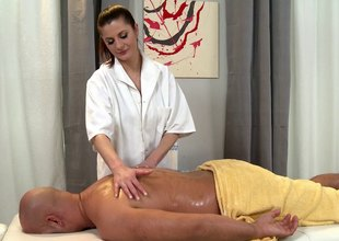 Naughty masseuse takes a ride on her client's wang after a blazing massage