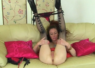 Horny British housewife playing with her moist pussy