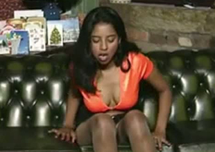 Brownskinned Indian skank stripping and rubbing her body sensually