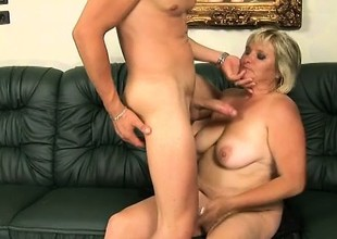 Heavy aged woman Kokai gives a young stud a sloppy blowjob