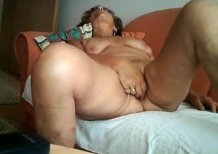 Gilf masturbates with a vibrator together with rides senior man on the sofa