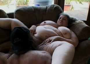 Fat tart lays down and lets her man work around her chubby body