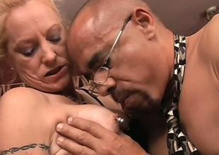 Ravishing grown-up woman with nipple piercing has wild interracial banging