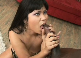 Hot Asian slut gobbles up a chubby black, fucks him, and sucks out his cum