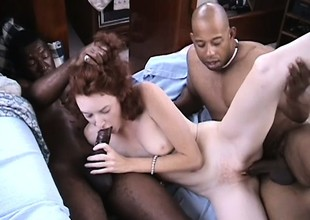 Redhead loves having her pierced pussy fucked by fat black cocks