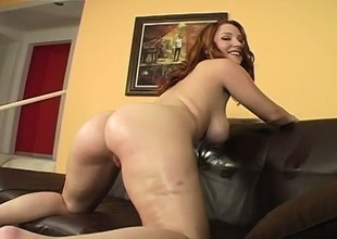 Oiling redhead's enormous boobies up in preference to to an stabbing pussy plowing
