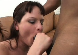 Honcho brunette chokes down a large black cock added to gets her ass nailed