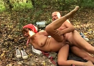 Horny granny sucks a big dick and enjoys a hard pounding in the forest
