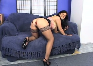 Inked hottie acquires down on her knees to suck on an XXL meat stick