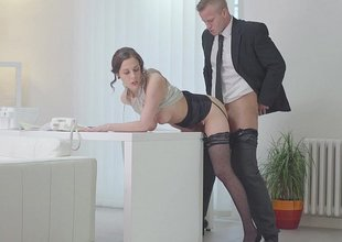 Secretary inclination over the desk and fucked