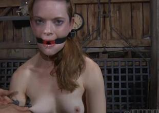 Tormented slave is giving old hand a lusty oral