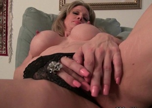 American milf Tracy peels off her pantyhose and masturbates