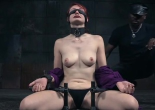 Collared increased by tied redheaded beauty in a dungeon
