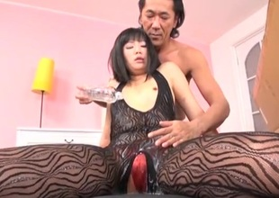 Oriental generalized in a body stocking coated in slippery oil