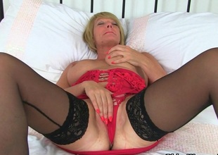 British milf Lulu plant her large naturals and moist pussy
