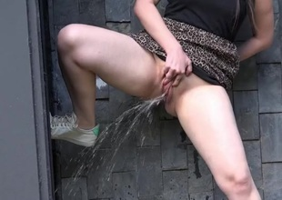 Curvy babe does a messy piss in public