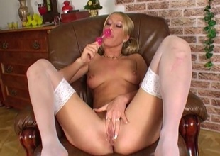 Beauty in white stockings has hawt sex with a bauble