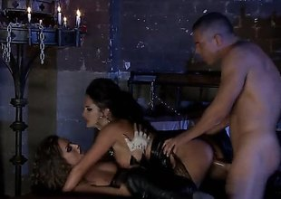 Alektra Blue and Tori Black are in a threesome with a dude in a dungeon that is only lit by candles. They are doing some enslavement in this sexy and amazing scene.