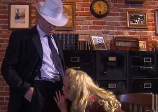 Golden haired cosset Cassie Young gives headjob to man in white hat with her titties out and then gets her pink love hole penetrated. Behold 'em have passionate office sex in this steamy scene