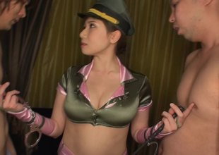 Military Oriental babe wears her uniform during a threesome