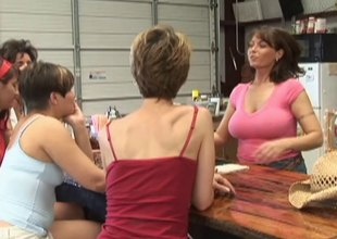 Lesbo sex on the bar with a pair of curvaceous babes