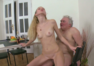 Skinny blond girlfriend fucks her BF with an increment of his old grand-dad