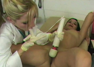 Bootylicious brunette visits doctor and gets pussy teased with vibrator