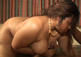 Black whore hither a gigantic ass is deepthroating her lover's sombre wang