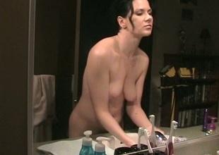 Flirty brunette enjoys a solo masturbation force in the baths