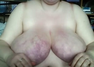 Wicked fat white whore with purple boobs masturbates on cam