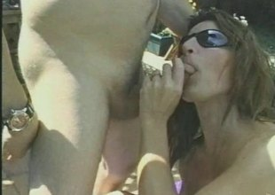 Seductive cougar coupled with her hubby enjoy making out hardcore outdoors