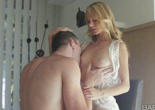 Scrawny blonde screwing her hung boyfriend and making him cum hard