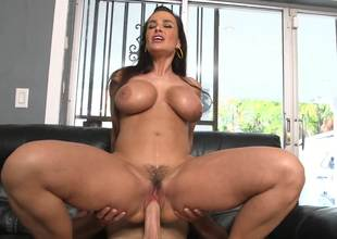 Lisa Ann is filmed as she rides a guys pecker like a cowgirl here