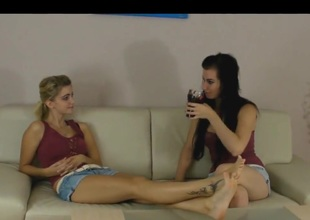 Lesbian allies admire sexy feet with chocolate