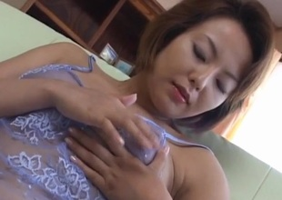 Rio Kurusu puts vibrator on her hairy crack in this world lace