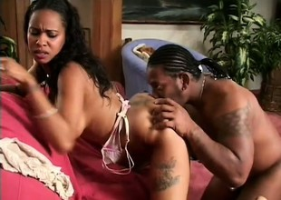 Black chick with a gigantic ass gets fucked beyond everything the sofa by her man