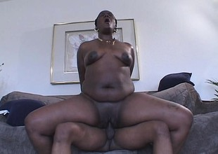 Black hoochie mama nearby high heels rides on a dick like a total champ