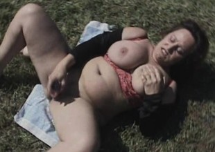 Fat old bitch uses a huge dildo to throbbing her aged wet crack outdoors
