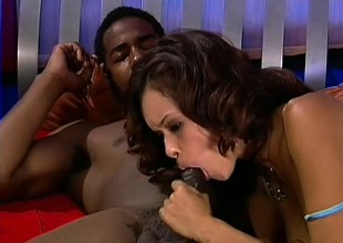 Diminutive ebony beauty more blue stockings feeds the brush passion for black cock