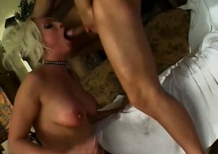 Dirty blonde cougar Nikki Orion welcomes a pompous prick in each hole