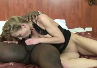 Older blonde slut satisfies her thirst for a big black dick